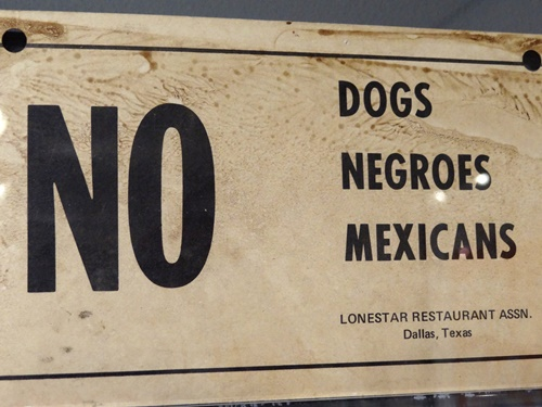 No dogs negroes Mexicans